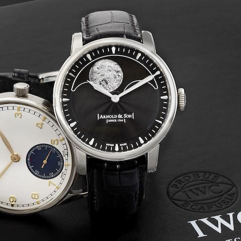A stainless steel manual wind wristwatch with moon phase