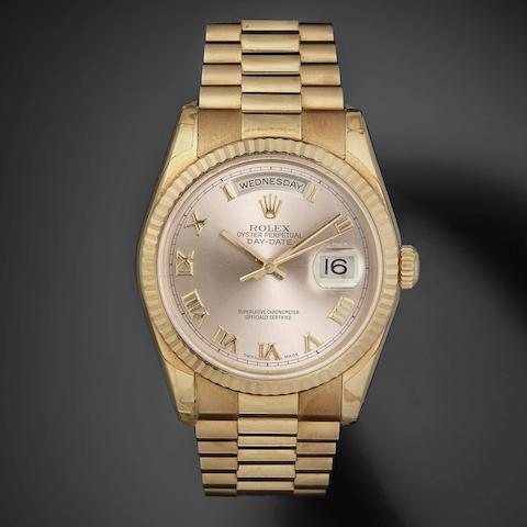 Rolex. A fine 18K rose gold automatic calendar bracelet watch