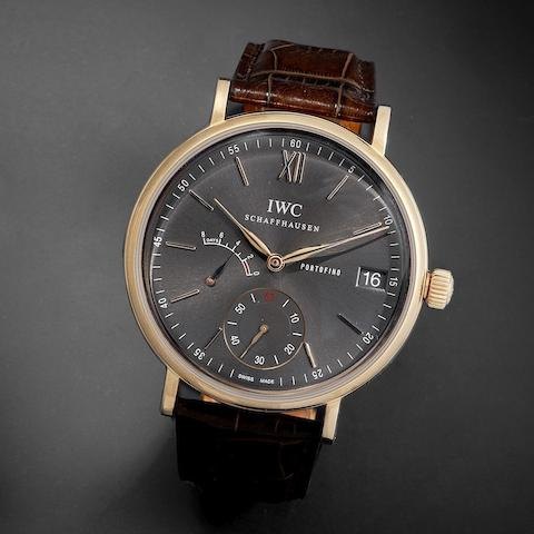 IWC. A fine 18K rose gold manual wind calendar wristwatch with 8 day power reserve