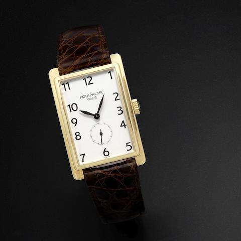 An 18K gold manual wind wristwatch