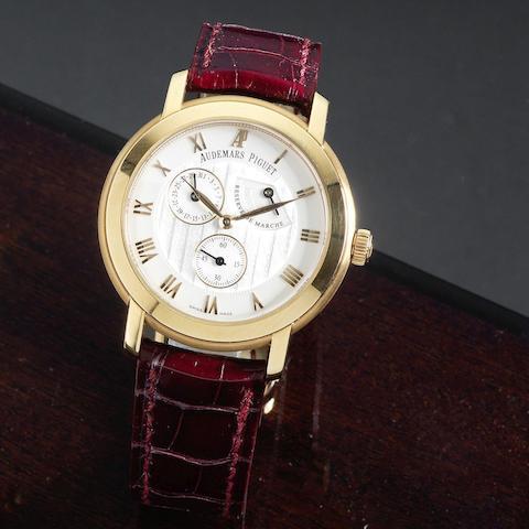 An 18K rose gold manual wind calendar wristwatch with power reserve