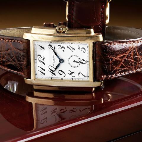 An 18K rose gold manual wind rectangular wristwatch