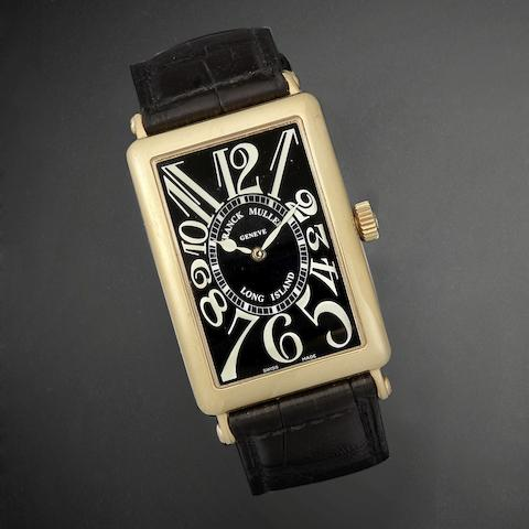 An 18K gold automatic wristwatch