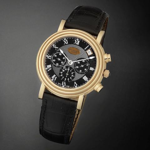 An 18K gold automatic calendar chronograph wristwatch