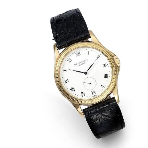 An 18K rose gold manual wind wristwatch with enamel dial