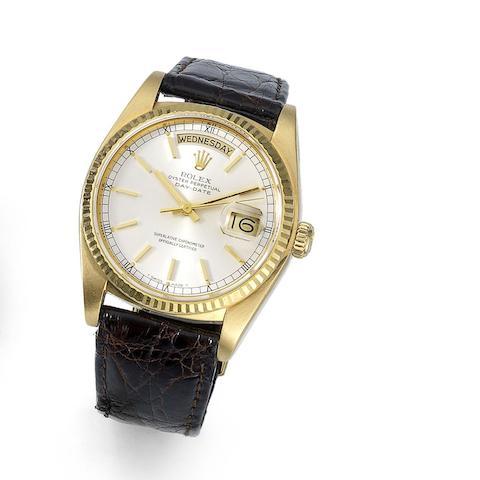 Rolex. An 18K gold automatic calendar wristwatch