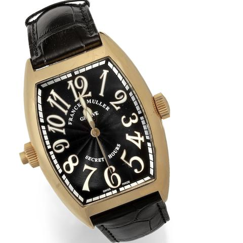 A large 18k rose gold automatic wristwatch with unusual time display