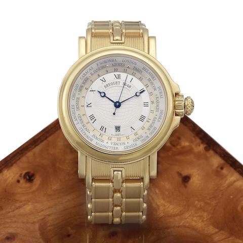 Breguet. An 18K gold automatic calendar bracelet watch with world time