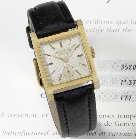 An 18K gold manual wind square wristwatch