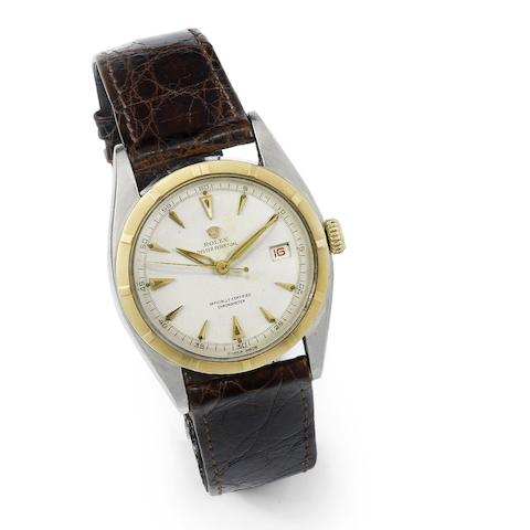 Rolex. A stainless steel and gold automatic calendar wristwatch with red date