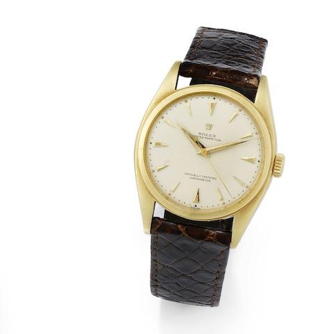 Rolex. An 18K gold automatic wristwatch