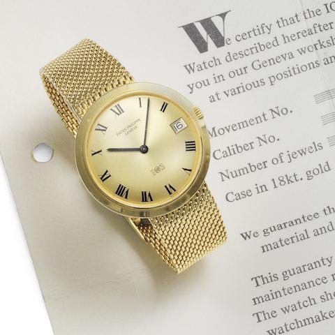 An 18K gold automatic calendar bracelet watch
