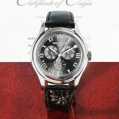A fine 18K white gold automatic annual calendar wristwatch with power reserve