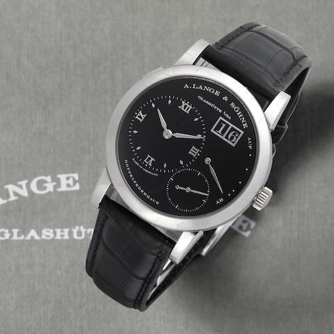 A. Lange & Söhne. A fine platinum manual wind calendar wristwatch with power reserve