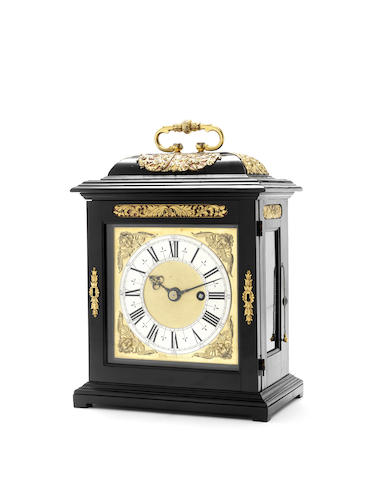 A fine late 17th century gilt brass mounted ebony table timepiece with slide quarter repeat and Exhibition Provenance.