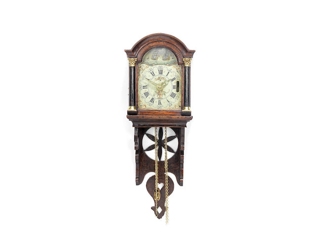 A second quarter of the 19th century Dutch oak wall clock or 'staartschippertje'