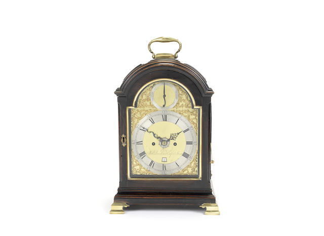 A second half of the 18th century ebonised triple pad top table clock with alarm and hour repeat