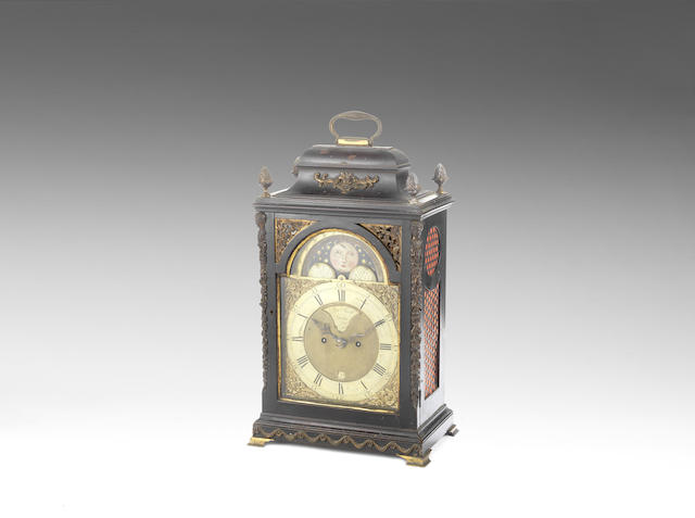 A mid 18th century ebonised table clock with moonphase indication