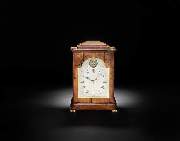 An interesting early 19th century rosewood travelling timepiece with visible balance escapement
