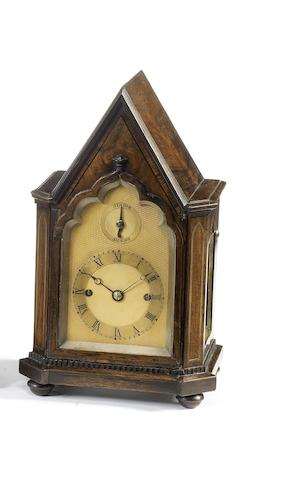 A small second quarter of the 19th century brass-inlaid rosewood striking clock of small size