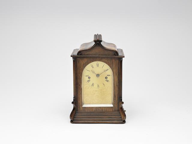 A third quarter of the 19th century rosewood mantel clock