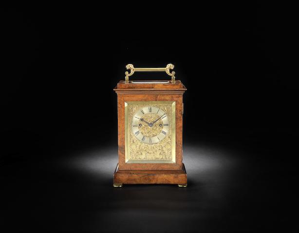 A good mid 19th century walnut striking travelling clock