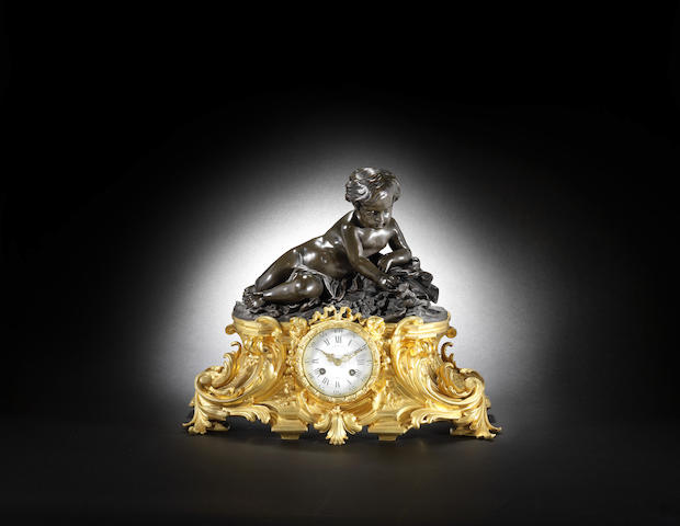 A good late 19th century French gilt and patinated bronze mantel clock