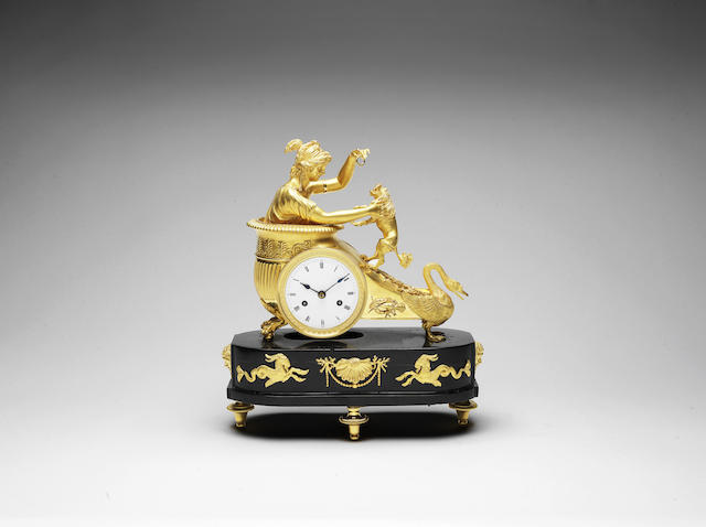 A fine early 19th century French ormolu and black marble mantel clock
