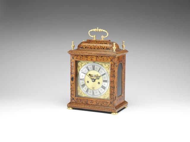 A fine early 18th century quarter repeating walnut marquetry inlaid table clock