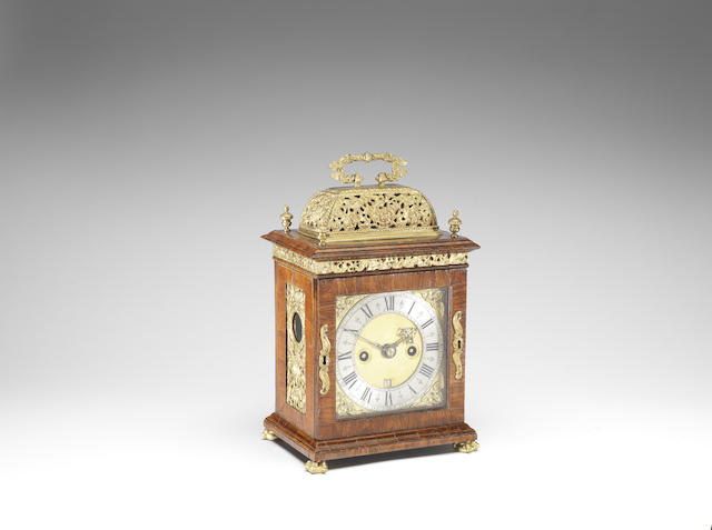 A 17th century olivewood table clock with later brass mounts