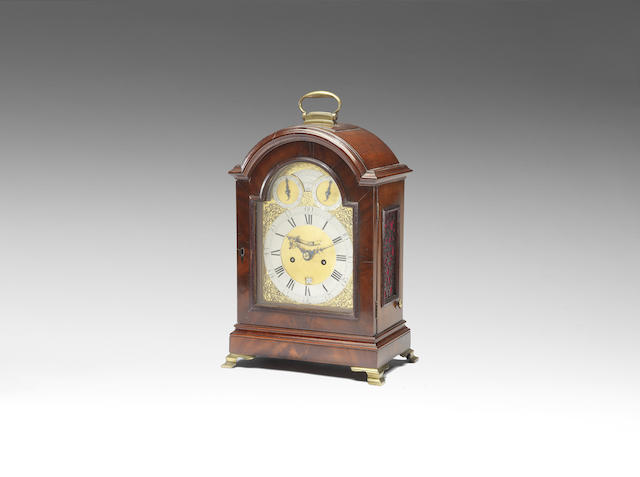 A mahogany table clock with pull quarter repeat