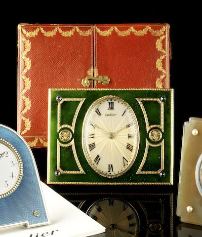 An early 20th century gold and sapphire mounted nephrite desk timepiece in the original fitted case