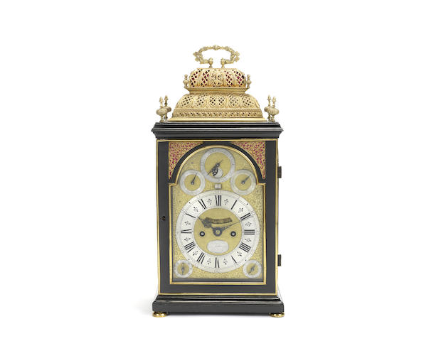 An early 18th century ebonised table clock with calendar, moonphase and pull quarter repeat for the French market