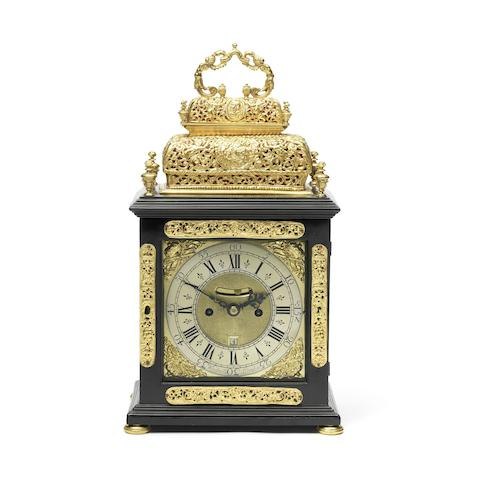 A good early 18th century ebony veneered double basket top quarter repeating table clock