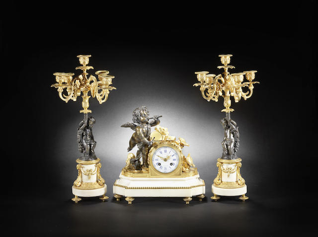 A good early 20th century French gilt and patinated bronze marble clock garniture