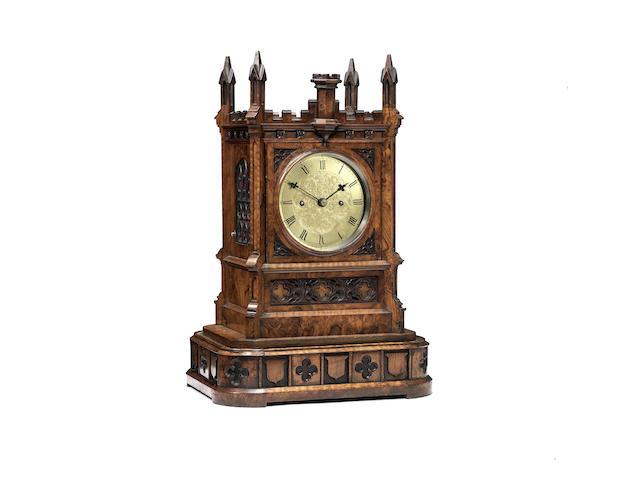 A fine mid 19th century burr walnut quarter striking table clock