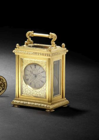 A good mid 19th century English engraved gilt bronze travelling timepiece