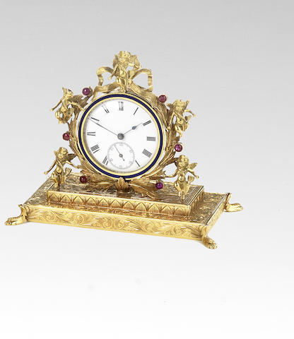 An early 20th century yellow metal and ruby boudoir timepiece