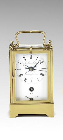 A rare second quarter of the 19th century French brass grande and petite sonnerie striking carriage clock