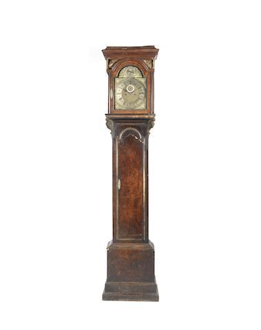 A rare early 18th century walnut longcase clock