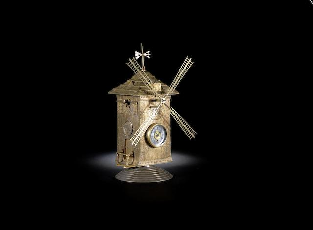 A 19th century French brass automata windmill timepiece