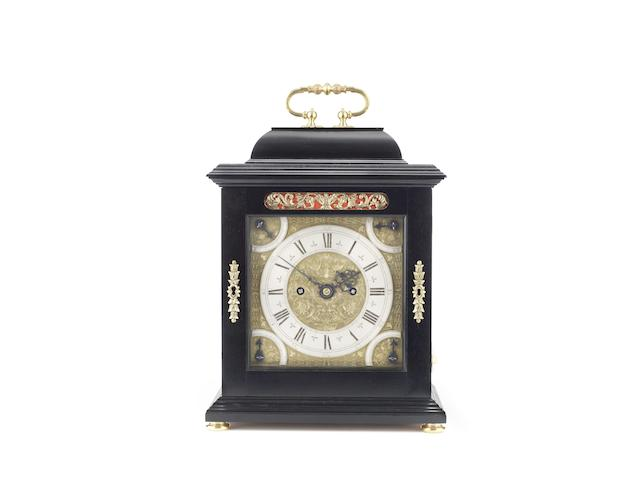 A finely crafted modern ebonised table clock with pull quarter repeat in the 17th century manner