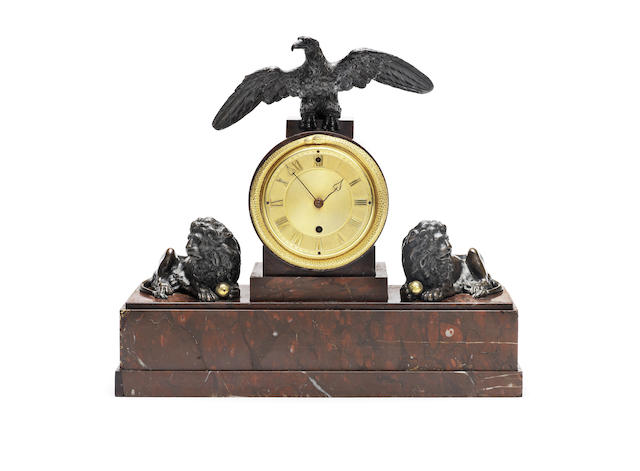 An early 19th century rouge marble and bronze mantel timepiece