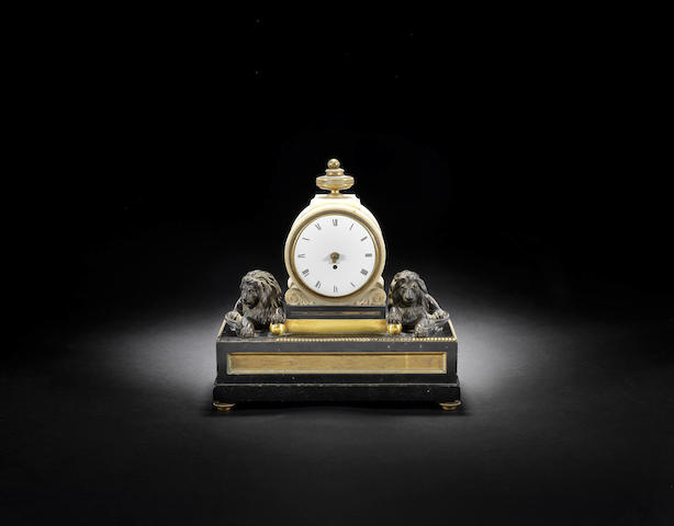 An historically interesting late 18th century gilt and patinated bronze and black marble timepiece