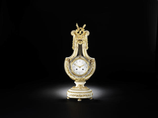 A good late 19th century French ormolu-mounted white marble lyre clock with swinging paste-set bezel
