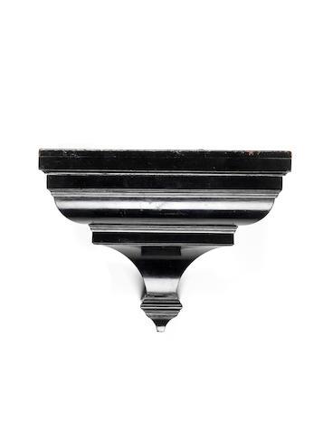 An early 18th century ebony wall bracket