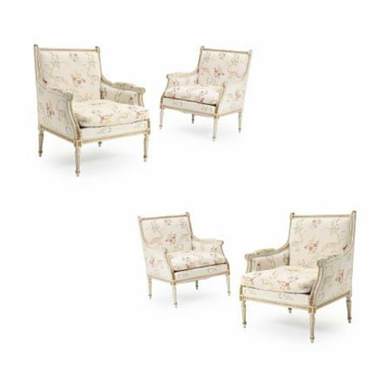 A set of four white and gold painted bergères