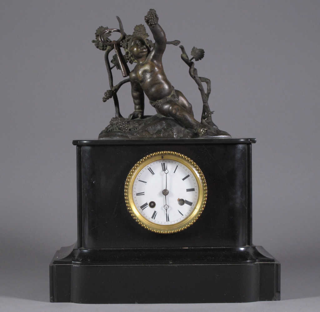 Black marble clock topped