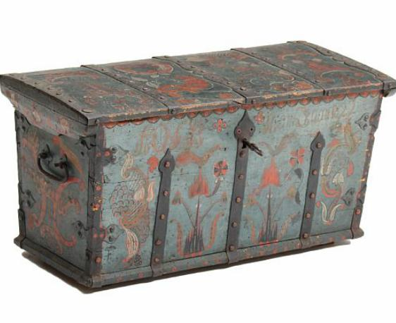 An 18th century painted Baroque chest, richly decorated with rocailles, flowers and foliage