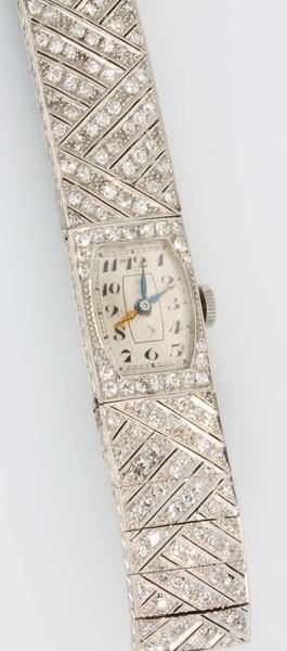An Art Deco lady's platinum diamond set tablet wristwatch on a silk strap